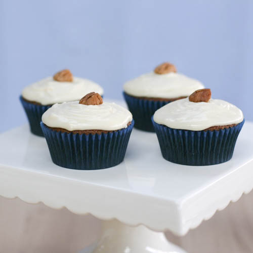 Carrot Cupcakes with Maple Cream Cheese Frosting | butter sugar flour